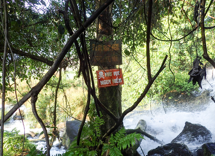 Danger sign near waterfall