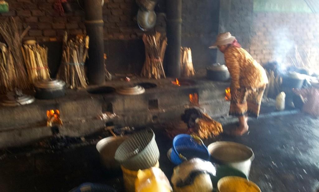Woman cooking crabs at Kep Crab Market, Cambodia