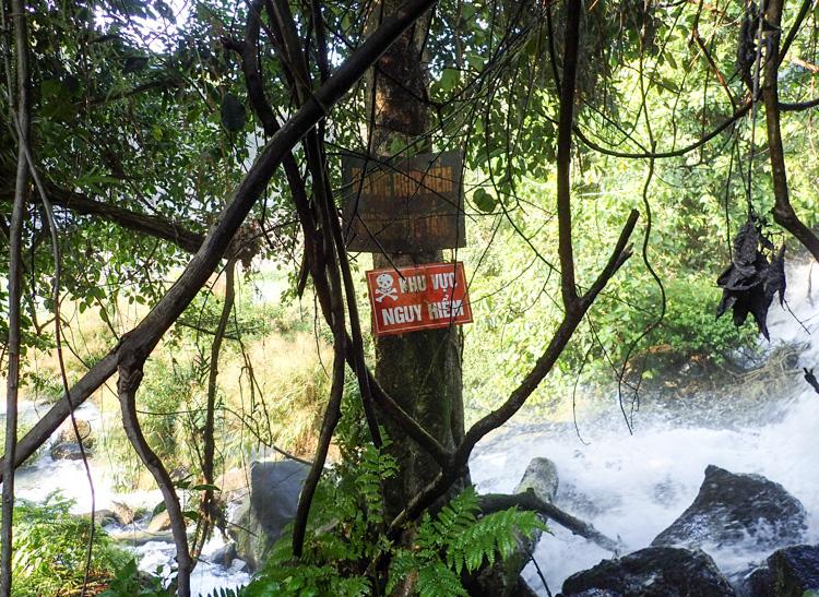 Danger sign near waterfall