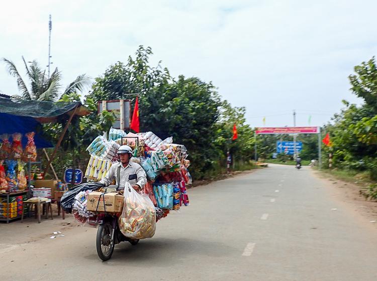 An overloaded scooter in Ben Tre, Vietnam